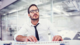 Composite image of business worker with reading glasses on computer
