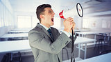 Composite image of businessman with megaphone
