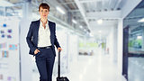 Composite image of businesswoman with suitcase