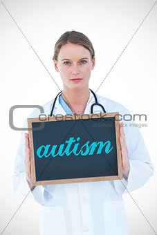 Autism against doctor showing chalkboard