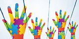 Composite image of autism awareness hand