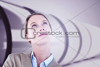 Composite image of thoughtful businesswoman in suit