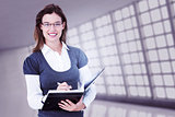 Composite image of happy woman writing in diary