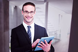 Composite image of happy businessman using his tablet pc