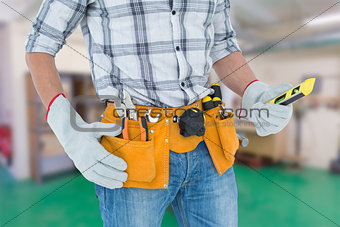 Composite image of technician holding spirit level over white background