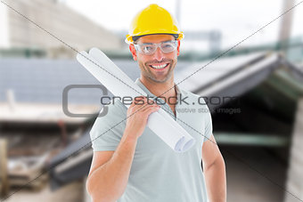 Composite image of architect with plan