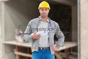 Composite image of architect looking at camera