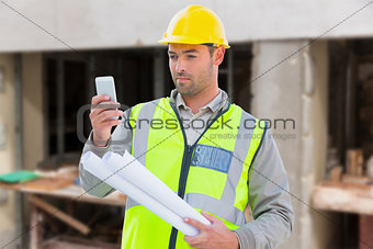Composite image of architect on the phone