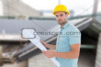 Composite image of confident male architect holding blueprint