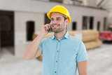 Composite image of happy male architect conversing on mobile phone
