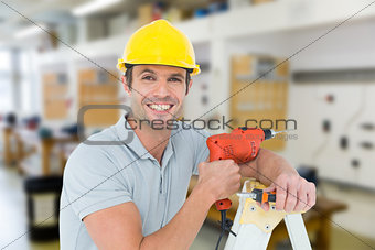 Composite image of happy technician holding drill machine while leaning on ladder