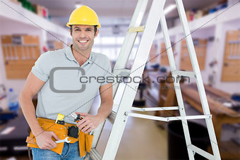 Composite image of worker holding tools while leaning on step ladder