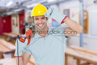 Composite image of handsome architect holding drill machine