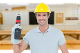 Composite image of confident carpenter holding cordless drill machine