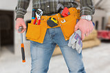 Composite image of manual worker holding gloves and hammer