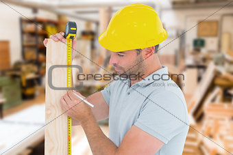 Composite image of carpenter using measure tape to mark on wooden plank