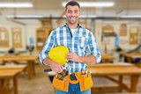 Composite image of smiling handyman holding hardhat and hammer