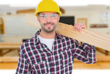 Composite image of handyman holding wood planks