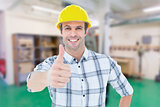 Composite image of architect showing thumbs up over white background