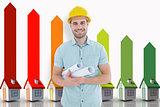 Composite image of happy male architect holding blueprints