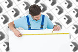 Composite image of carpenter measuring blank bill board