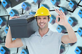 Composite image of worker carrying tool box on shoulder while gesturing ok sign