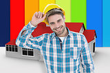 Composite image of confident male technicial wearing hard hat