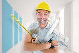 Composite image of portrait of smiling handyman holding various tools