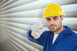 Composite image of confident repairman holding cables