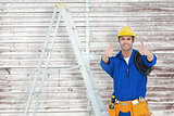 Composite image of happy electrician gesturing thumbs up by ladder