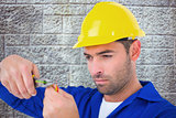 Composite image of electrician wearing hard hat while cutting wire