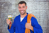 Composite image of smiling electrician with rolled wire and multimeter