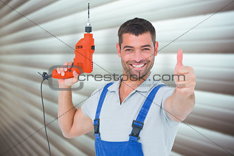 Composite image of smiling repairman with drill machine gesturing thumbs up