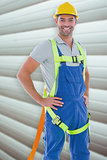 Composite image of builder in safety gear