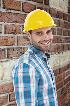 Composite image of confident repairman wearing hard hat