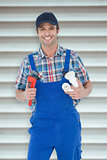 Composite image of plumber holding monkey wrench and sink pipe