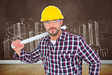 Composite image of handyman holding rolled up blueprint