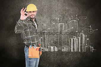 Composite image of smiling handyman gesturing okay