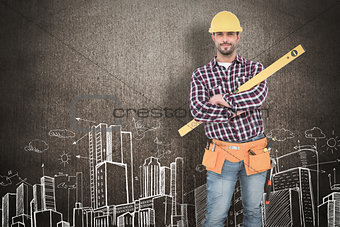 Composite image of smiling handyman holding spirit level