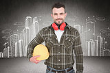 Composite image of handyman with earmuffs holding helmet