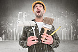 Composite image of screaming manual worker holding various tools