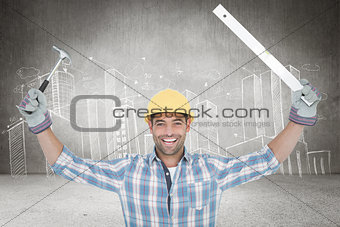 Composite image of smiling handyman holding hammer and level