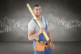 Composite image of worker holding spirit level