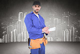 Composite image of handyman in blue overall writing on clipboard