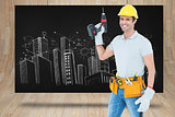 Composite image of carpenter holding cordless drill over white background