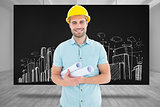 Composite image of happy male architect holding blueprints