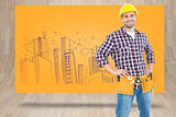 Composite image of handyman wearing tool belt while standing hands on hips