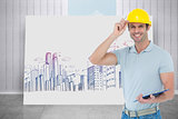 Composite image of architect wearing hard hat while holding clip board