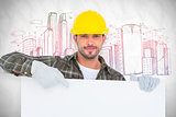 Composite image of handyman holding and pointing at blank board