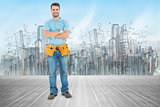 Composite image of portrait of happy repairman standing arms crossed